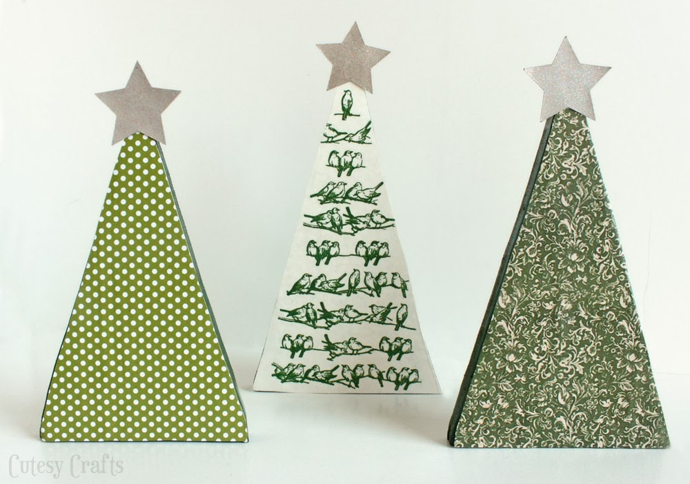 using some paper and different formulas of mod podge i was able to dress up some scrap wood to make these cute little christmas trees