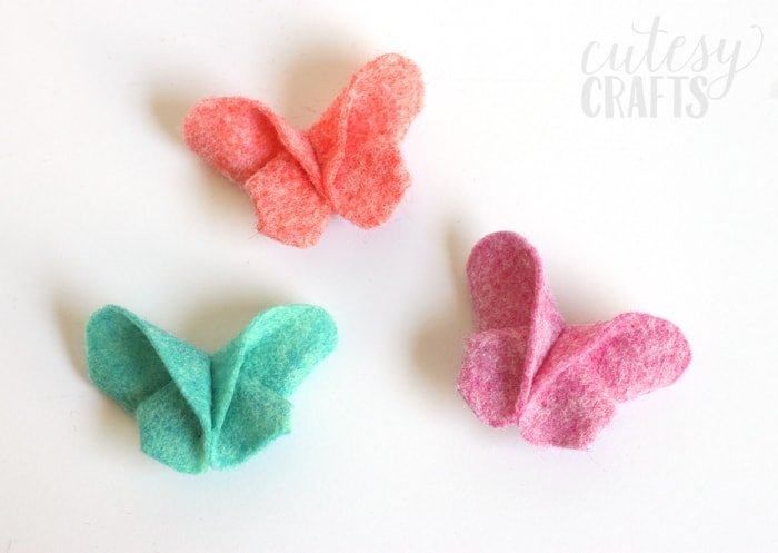 Fold felt like origami to make these adorable felt butterfly hair clips!