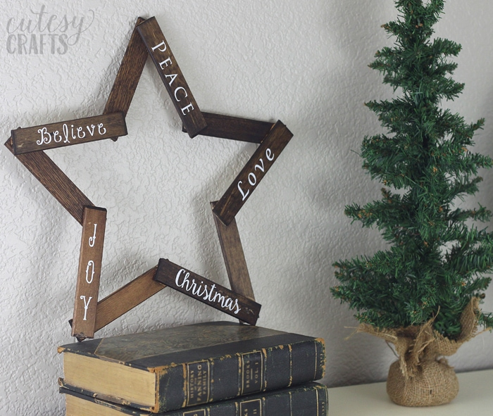 Make this pretty wooden star DIY Christmas decoration for your holiday mantle! It's so easy to make and looks so pretty when it's done!