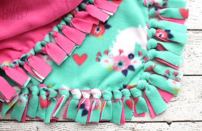 How to make a tie blanket from fleece.