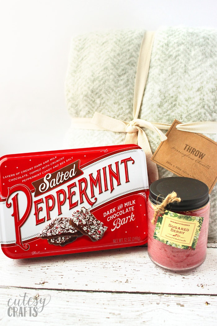 Chenille throw, candle and peppermint bark tin from Cost Plus World Market.